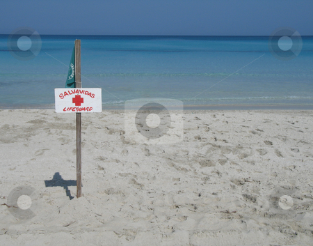 Lifeguard sign on the beach stock photo,  by Mbudley Mbudley
