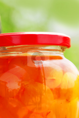 Jar with sweet charries stock photo, Glass jar with white cherries close up by Julija Sapic