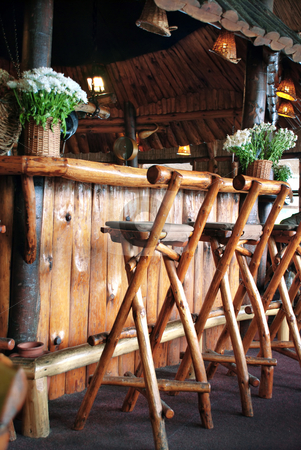 Wooden bar stock photo, Wooden bar and chairs in small restaurant by Julija Sapic
