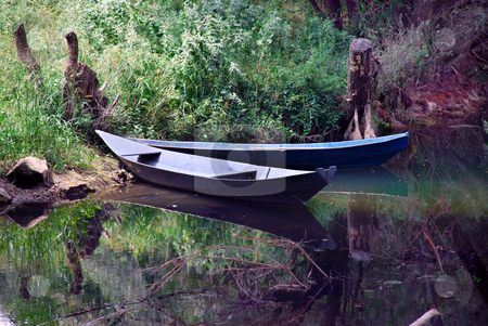 Boats over tranquil water stock photo, Two small  boats over tranquil river landscape by Julija Sapic