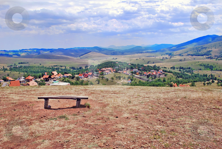 Rural landscape stock photo, View on serbian village, hills and meadows by Julija Sapic