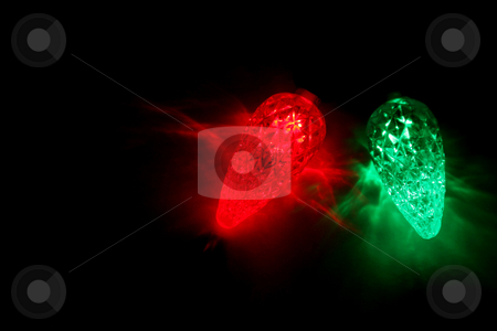 Two Christmas Lights stock photo, Red and green LED Christmas lights. by Chris Hill