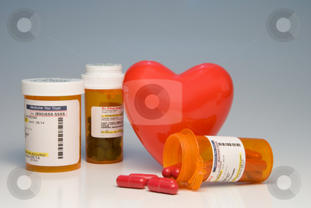 Prescription Medication stock photo, A heart and bottles of prescription medication. by Robert Byron