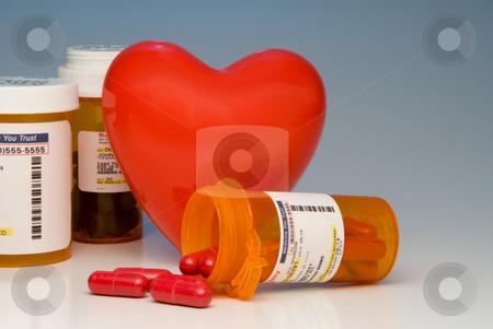 Prescription Medication stock photo, A heart and bottles of prescription medication. by Robert Byron