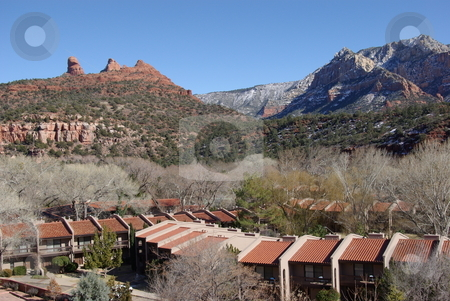 Sedona Architecture Blends In stock photo, SPRING IS COMING - The cottenwoods are still missing their leaves and the mountains in the background have a dusting of late February snow, but the red rock formations of Sedona, AZ are a year round attraction for tourists.  Notice how the architecture of this up-town Sedona resort in the lower foreground blends in with the natural red rock terrain(February, 2008). by Dennis Thomsen