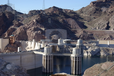 Lake Mead Side of Hoover Dam stock photo, Built on the Colorado River and the border of Arizona and Nevada, the Hoover Dam is a prime example of a man-made wonder.   This view from the east side, above the dam, shows some of the electrical generating structures.  It took four years to build the Hoover Dam between 1931-1935. by Dennis Thomsen