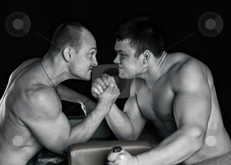 Power fighting stock photo, Two strong mans armwrestling in atheletic common-room by Vadim Maier