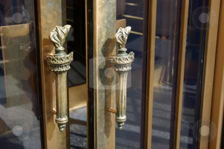Distinctive door handle stock photo, The distinctive brass door handles shaped like a torch grace all the entry doors to Las Vegas casino and hotel New York New York. by Dennis Thomsen