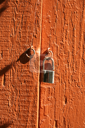 The red door. stock photo, The red door withe the iron padlock and iron ring. by Viachaslau Barysevich