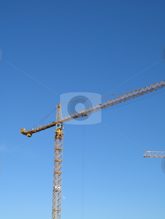 Yellow construction crane stock photo,  by Mbudley Mbudley