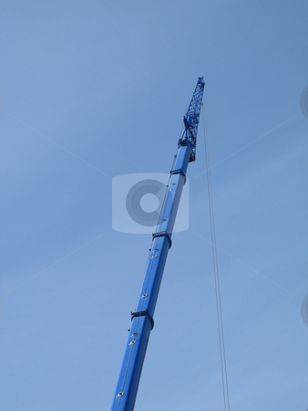 Blue construction crane stock photo,  by Mbudley Mbudley