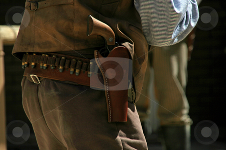 Gun Holster stock photo, Photo of a gun holster with gun and bullets on belt by Robin Russell