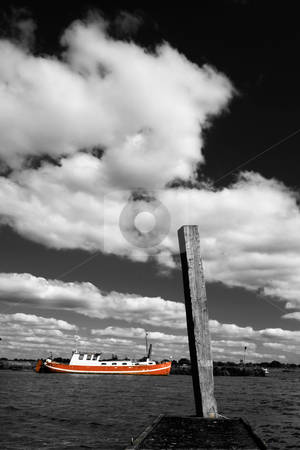 Orange boat stock photo,  by Vivek Chandrashekaran