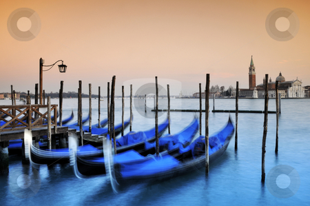 Gondolas, Venice Italy stock photo, Gondolas moored at the Piazza San Marco at dusk, with the Canal di San Marco and San Giorgio Maggiore church behind,Venice,Italy by Csaba Zsarnowszky