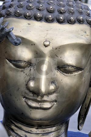 Buddha face stock photo, Buddha face, bronze statue by Csaba Zsarnowszky