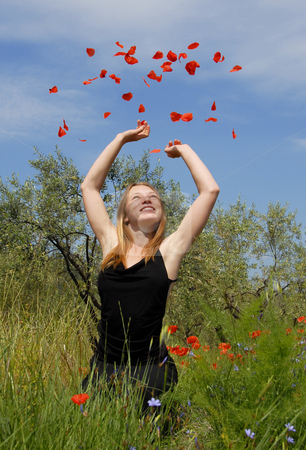 Teenager and poppies stock photo, Happy  teenager in a field of spring flowers by Bonzami Emmanuelle