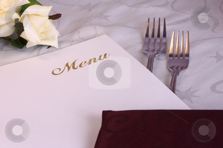 Restaurant Menu / Wedding Menu stock photo, A stylish wedding or restaurant menu and table setting, with silk flowers, forks and napkins by Mark Allchin