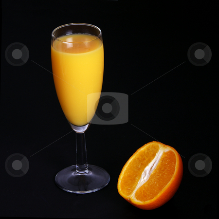Fresh Orange Juice in glass stock photo, A freshly squeezed orange drink with half orange by Mark Allchin