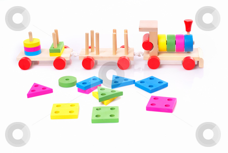 Wooden Toy Train stock photo, Wooden toy train against white background by Vadim Maier