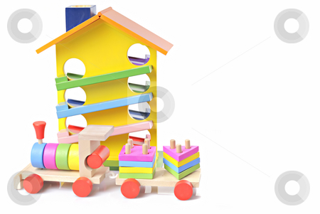 Toy wooden train and house stock photo, Wooden toy train against white background and wooden house by Vadim Maier