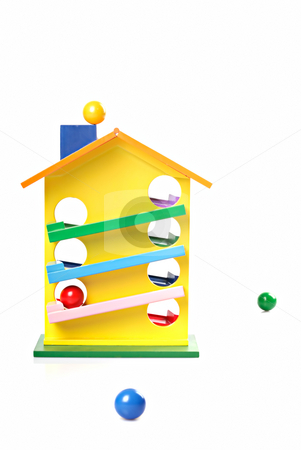 Toy wooden house stock photo, Toy wooden house with varicoloured ball \ white background by Vadim Maier