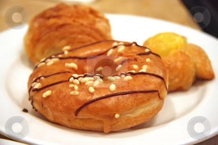 Assorted pastries stock photo, Various assorted pastries and donuts on  a plate by Kheng Guan Toh