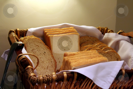Sliced bread stock photo, Sliced bread in a basket part of restaurant buffet breakfast by Kheng Guan Toh