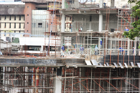 Construction site stock photo, Urban construction site with workmen in downtown manila by Kheng Guan Toh