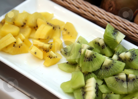 Kiwi fruit stock photo, Sliced golden and green kiwi fruits on plate by Kheng Guan Toh