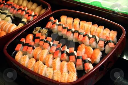 Sushi arrangement stock photo, Arrangement of sushi and sashimi in a restaurant setting by Kheng Guan Toh