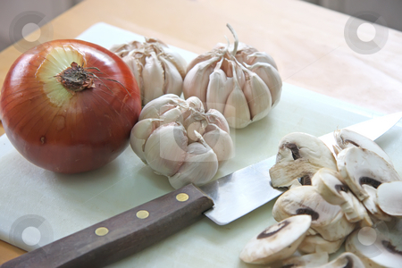 Onion garlic mushroom stock photo, Onion garlic cloves and sliced mushrooms on chopping board by Kheng Guan Toh