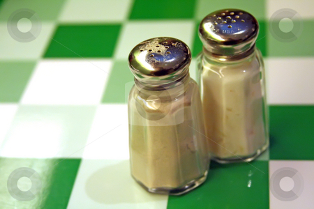 Salt and pepper stock photo, Salt and pepper shakers casual restaurant setting by Kheng Guan Toh