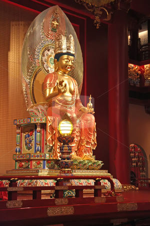 Golden buddha statue stock photo, Golden statue of buddha inside a chinese temple by Kheng Guan Toh