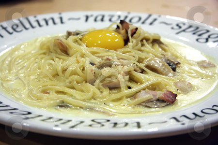 Spaghetti carbonara stock photo, Spaghetti carbanora with cream sauce and an egg by Kheng Guan Toh