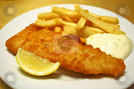 Fish and chips stock photo, Fish and chips on a white plate with tartar sauce by Kheng Guan Toh