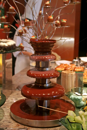 Chocolate, fountain stock photo, Chocolate fountain with fruit to dip in the chocolate by Kheng Guan Toh