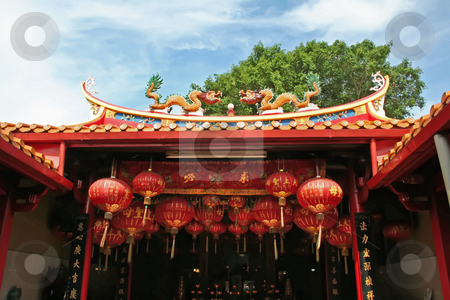 Chinese temple stock photo, Traditional chinese temple rooftop against blue sky by Kheng Guan Toh
