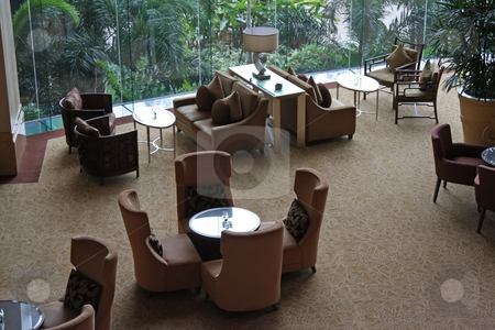 Cafe lounge stock photo, Elegant cafe lounge waiting area with tables and sofas by Kheng Guan Toh