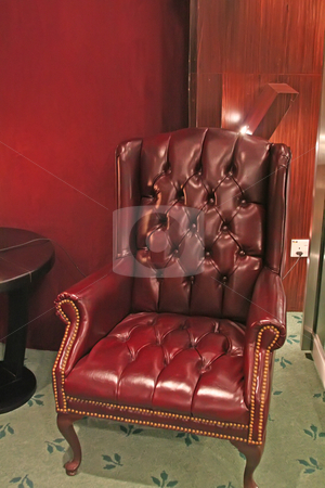 Traditional leather armchair stock photo, Old-fashioned traditional leather armchair in burgundy by Kheng Guan Toh