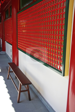 Chinese temple bench stock photo, Wooden bench in interior corridor of traditional chinese temple by Kheng Guan Toh