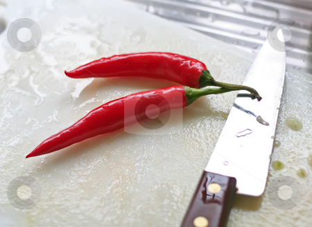 Fresh chillis kitchen stock photo, Fresh chillis on the chopping board cooking preparation in the kitchen by Kheng Guan Toh