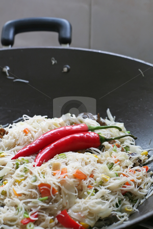 Fried asian noodles stock photo, A plate of fried asian noodles in wok with chillis by Kheng Guan Toh