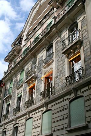 Swiss apartment stock photo, Traditional apartment house with flowers in windows in Geneva Switzerland by Kheng Guan Toh