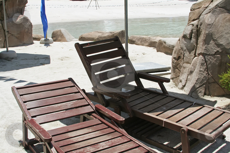 Wooden deck chairs stock photo, Wooden deck chairs tropical setting next to water by Kheng Guan Toh