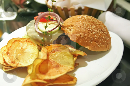 Elegant hamburger stock photo, Gourmet hamburger with chips elegant presentation in a restaurant by Kheng Guan Toh