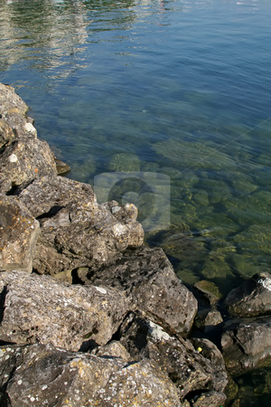 Mossy rocks stock photo, Moss covered broken rocks by the lakeside by Kheng Guan Toh