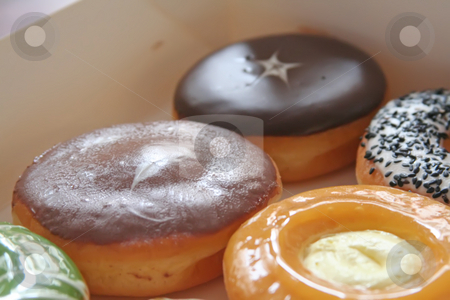 Assorted donuts stock photo, Assorted variety of donuts in a box by Kheng Guan Toh