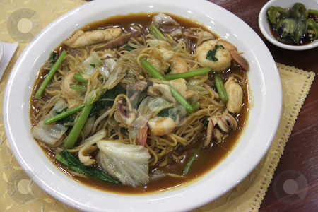 Seafood noodles stock photo, Fried seafood noodles with sauce traditional chinese cuisine by Kheng Guan Toh
