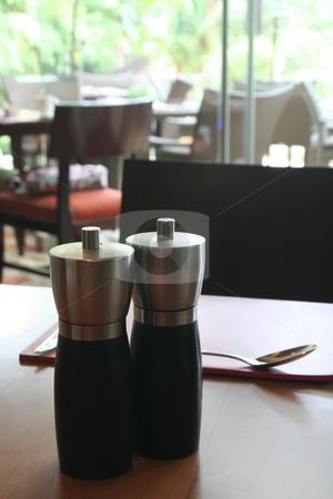 Salt pepper shakers stock photo, Modern design salt and pepper shaker in a restaurant by Kheng Guan Toh