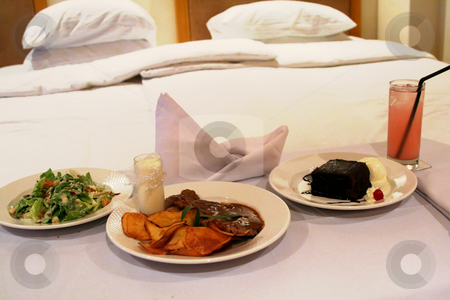 Room service stock photo, Room service food presentation with hotel bed in background by Kheng Guan Toh